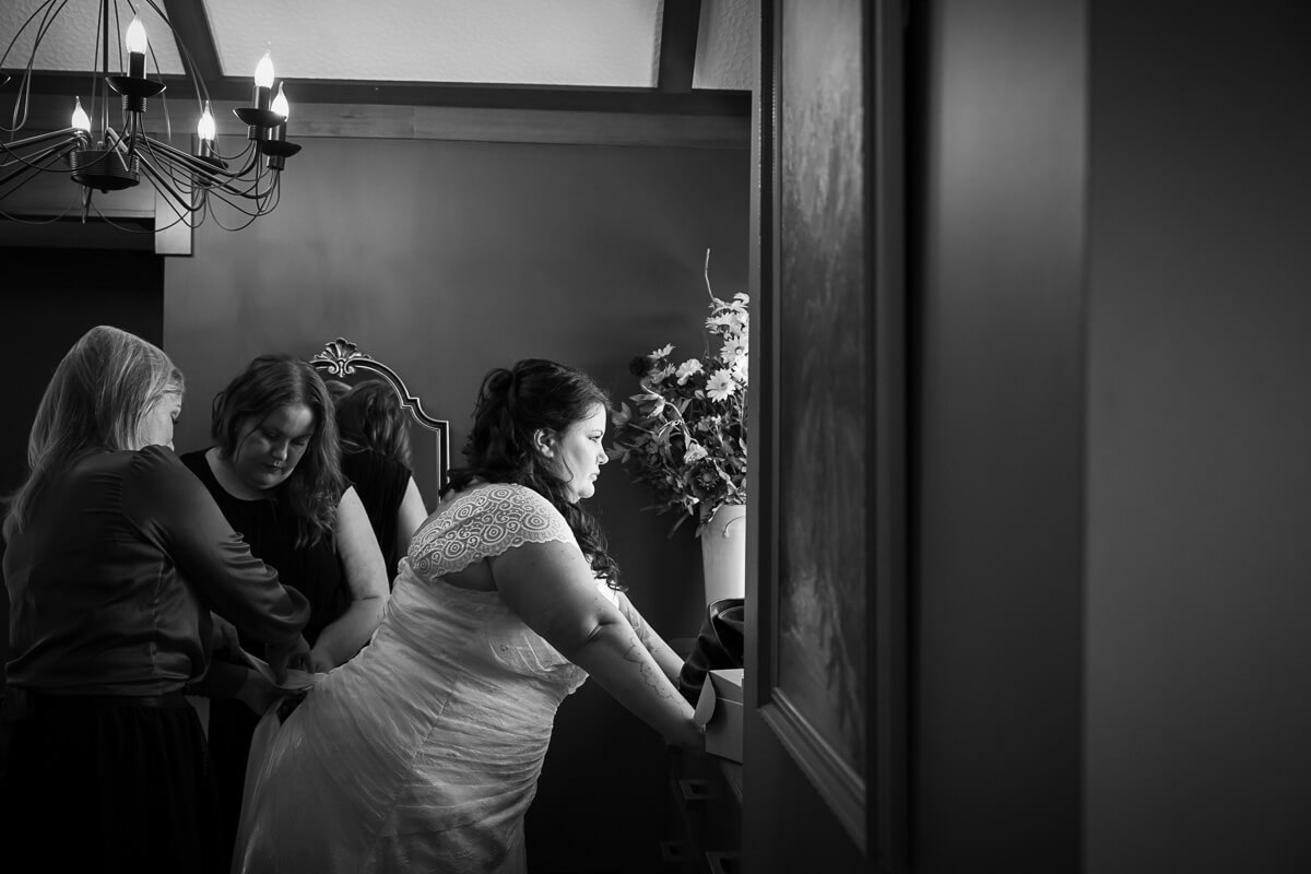 bride-getting-into-her-wedding dress