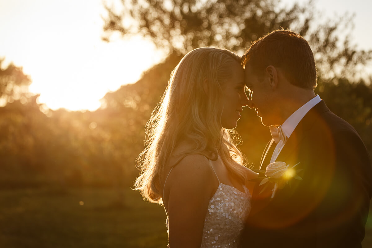 Sunset-wedding-photography-couple-in-goldenlight-facing-each-other