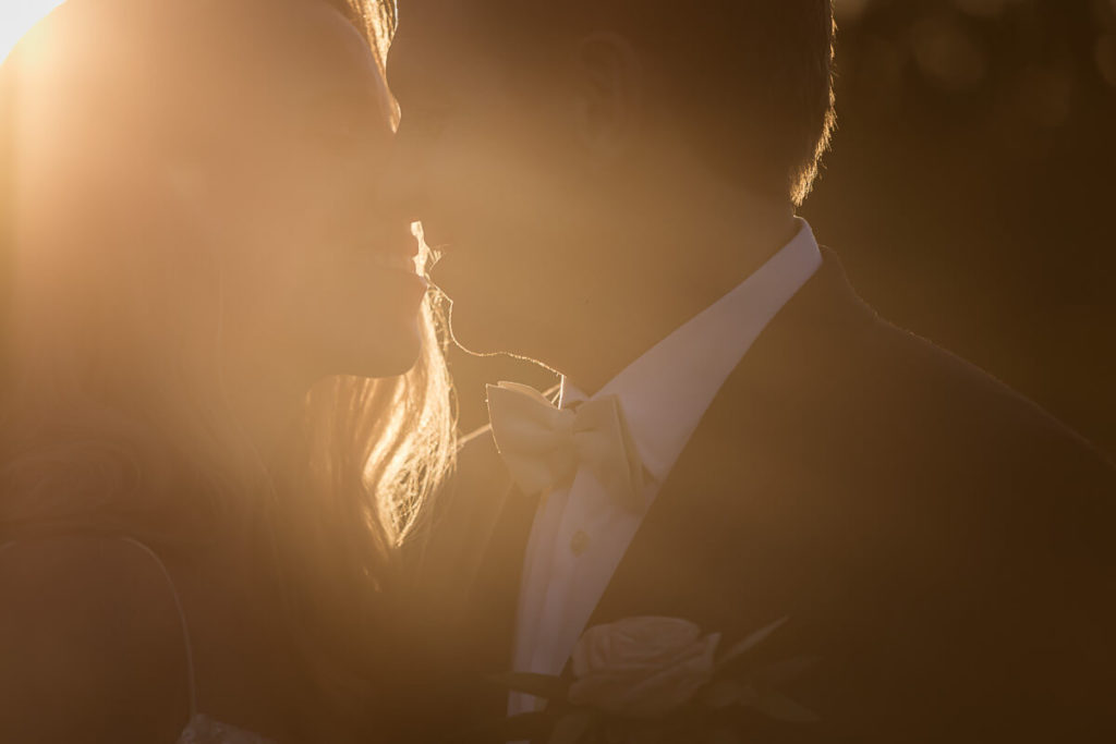 Sunset-wedding-photography-bride-and-groom-kissing