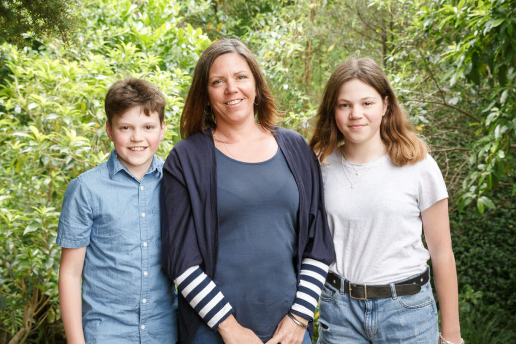 mum and two teen age kids in family portrait with native bush background