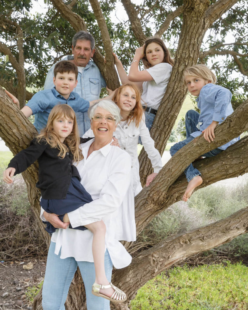 Grand  parents with grand children family portrait in tree