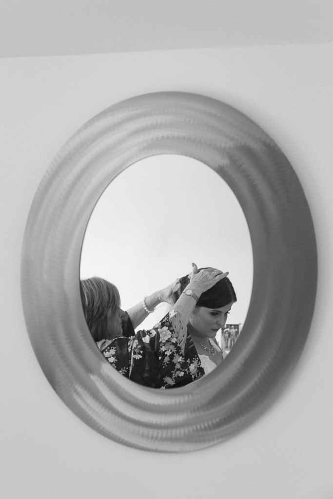 black and white image of a bride getting ready for her wedding