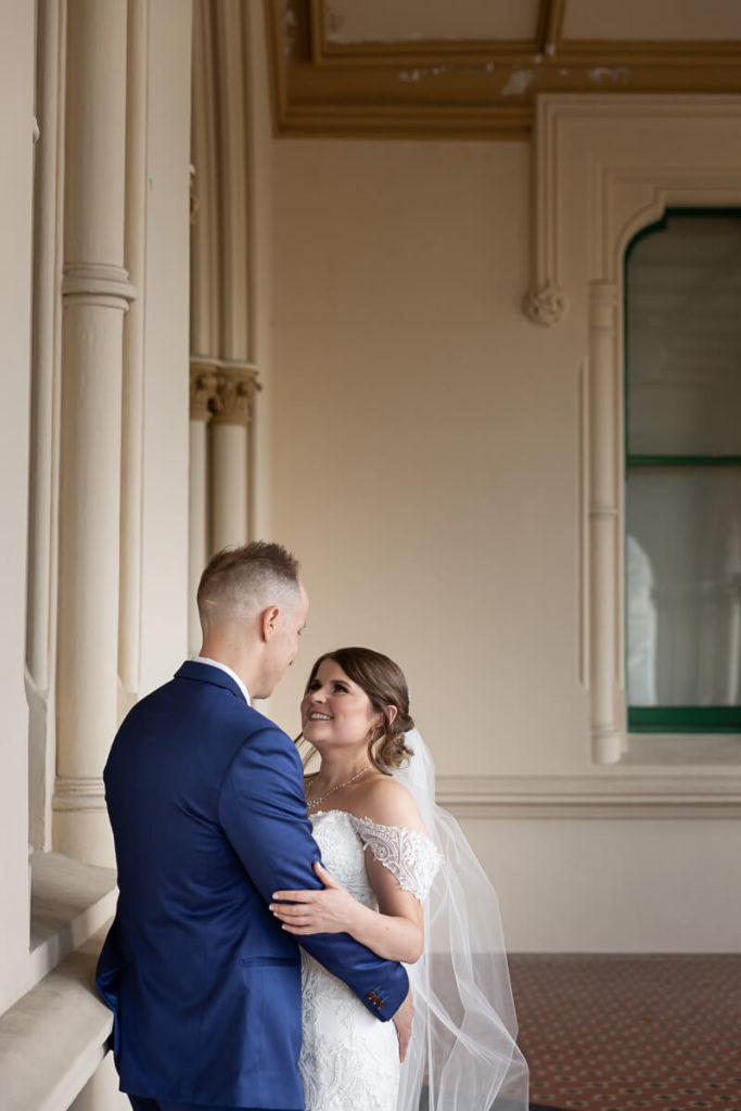 bride and groom enjoy so e quite time together after  wedding day first look