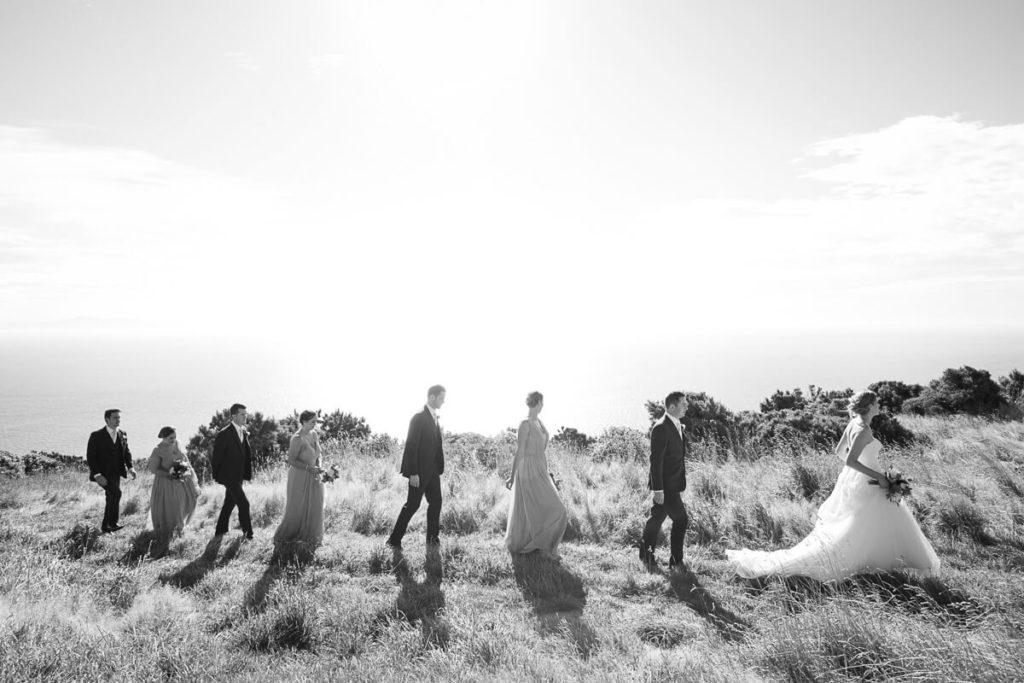 Large wedding party on clif to in blackand white