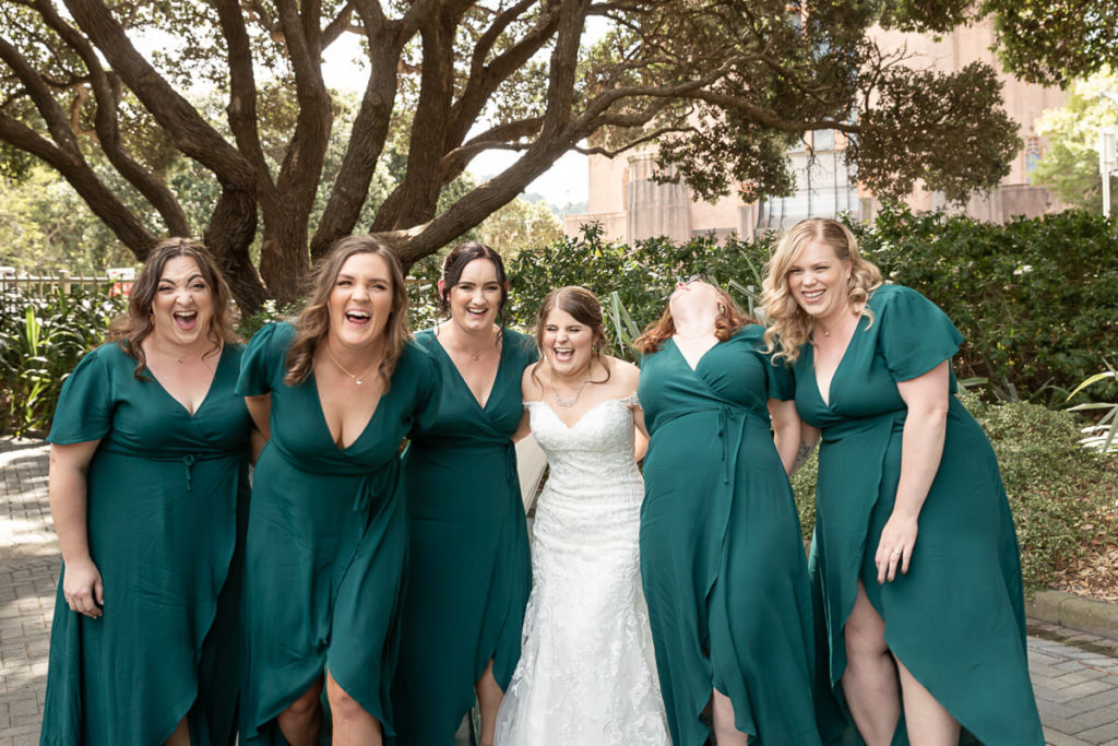 group of bridesmaids with bride laughing