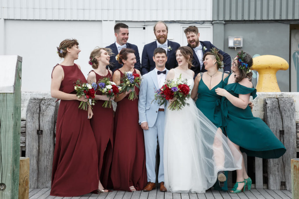 large wedding party on wellington water front