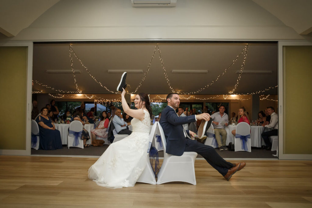 bride and groom playing the shoe game at anam cara gardens