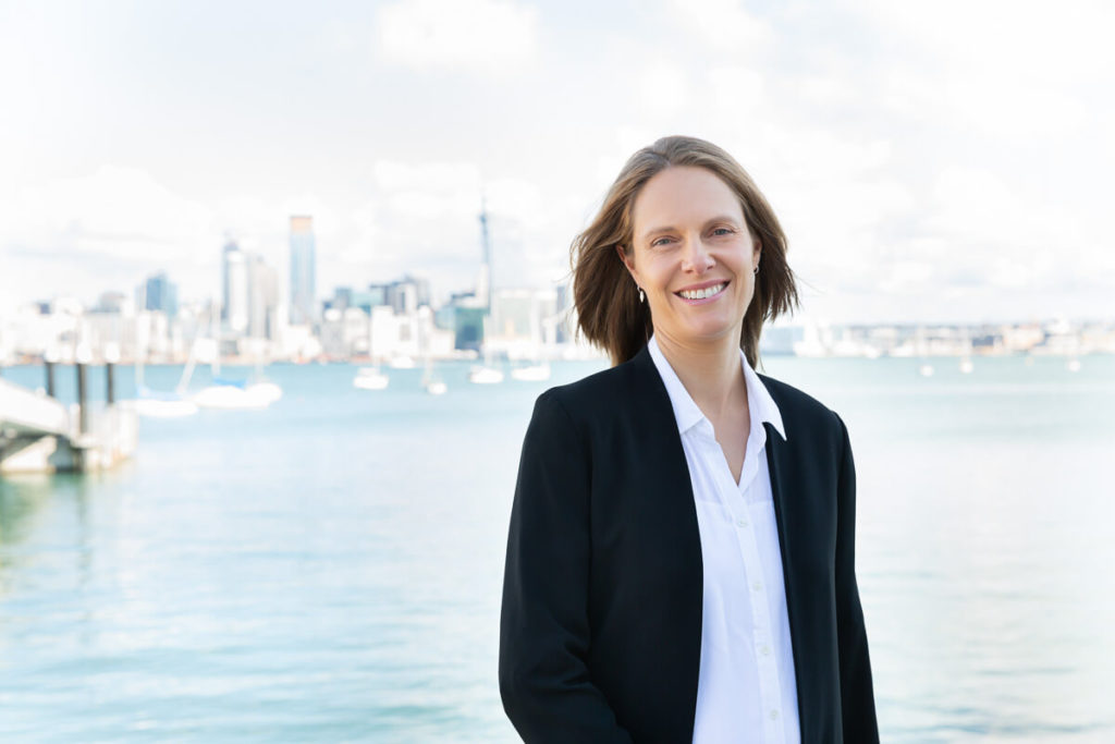 business branding photography of woman with auckland city in the background