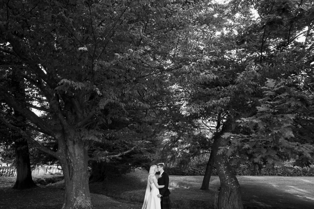 black and white photo of bride and groom in beautiful plamerston north garden