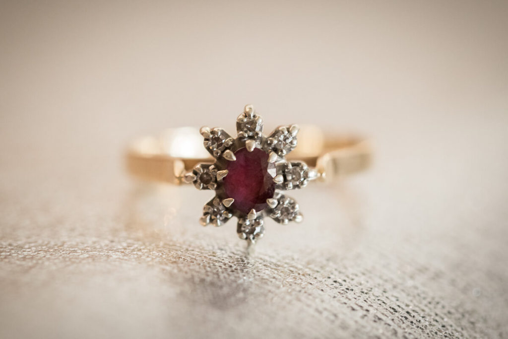 close up of a ruby engagmetn ring that is a start shape with dimond points