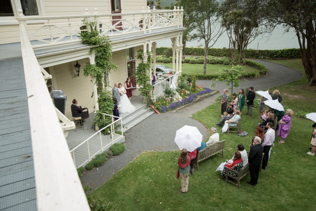 daytime wedding cereomy at gear homestead takaen from about the action
